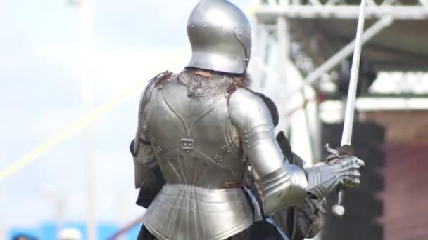 BULGAR, RUSSIA 11-08-2019: Knights having a battle on the field on a swords - medieval festival