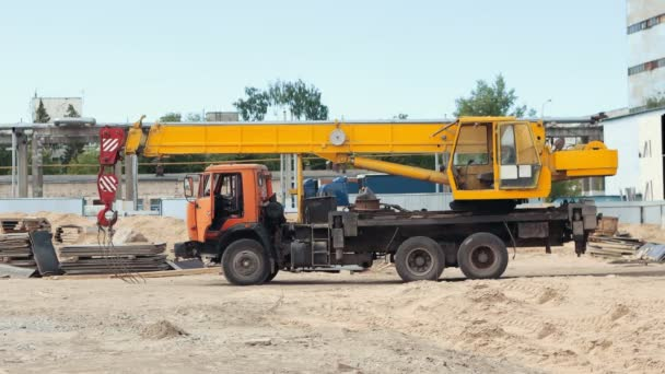 A machine with lifting crane parked on the construction site