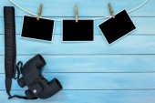 Blank instant photo frames on blue wooden background.