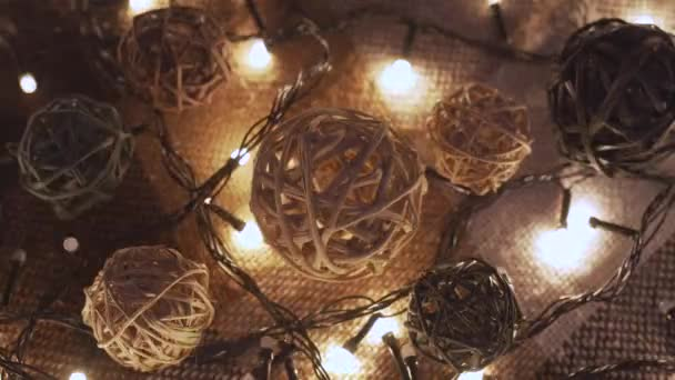 Close-up christmas garland and handmade balls on a playd with golden lights. Christmas concept. Home decor