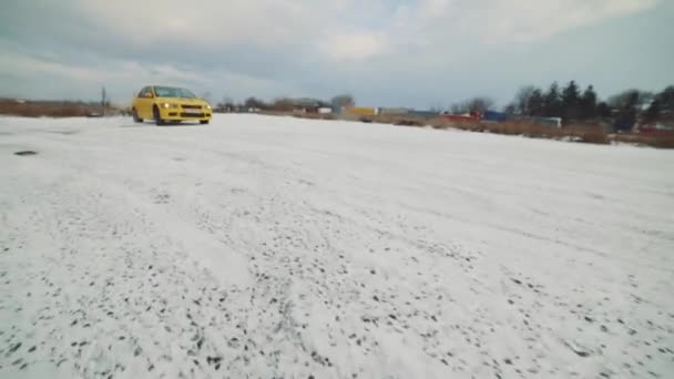 ODESSA, Ukraine- January 16, 2019. Professional racer training car drift on the snow rally track. Slow motion. Mitsubishi lancer