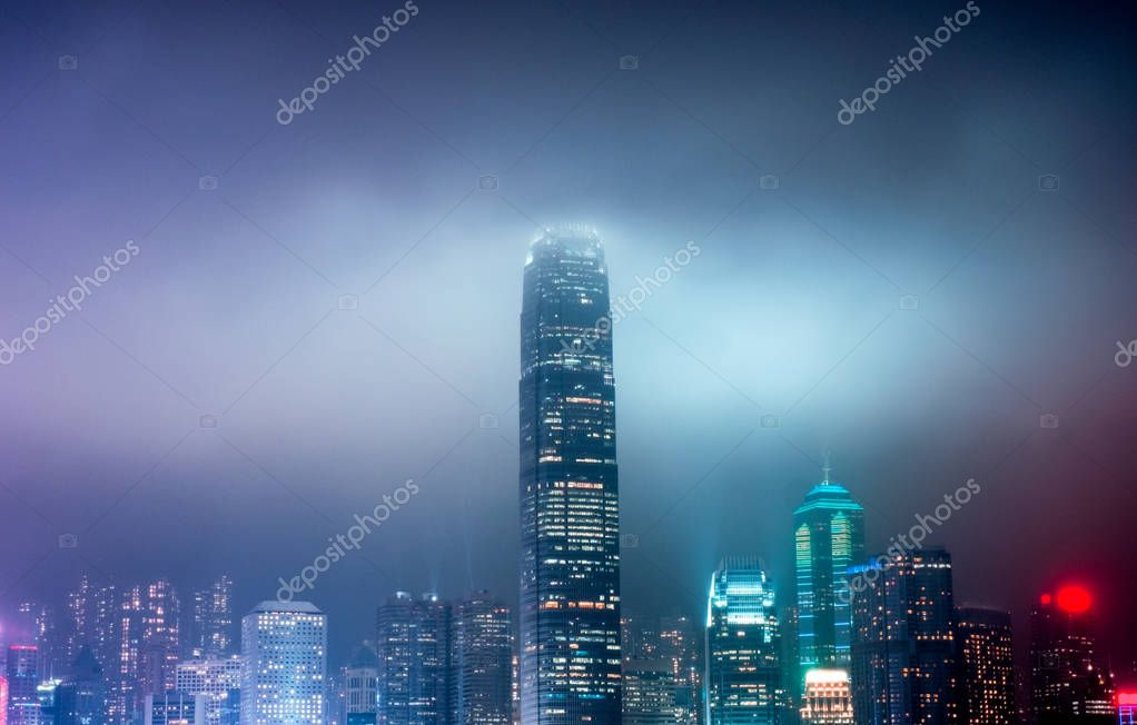 Colorful illuminated skyscraper on fog in festival at Hong Kong