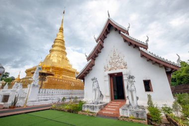 Ancient golden pagoda traditional northern at Wat Phra That Chae
