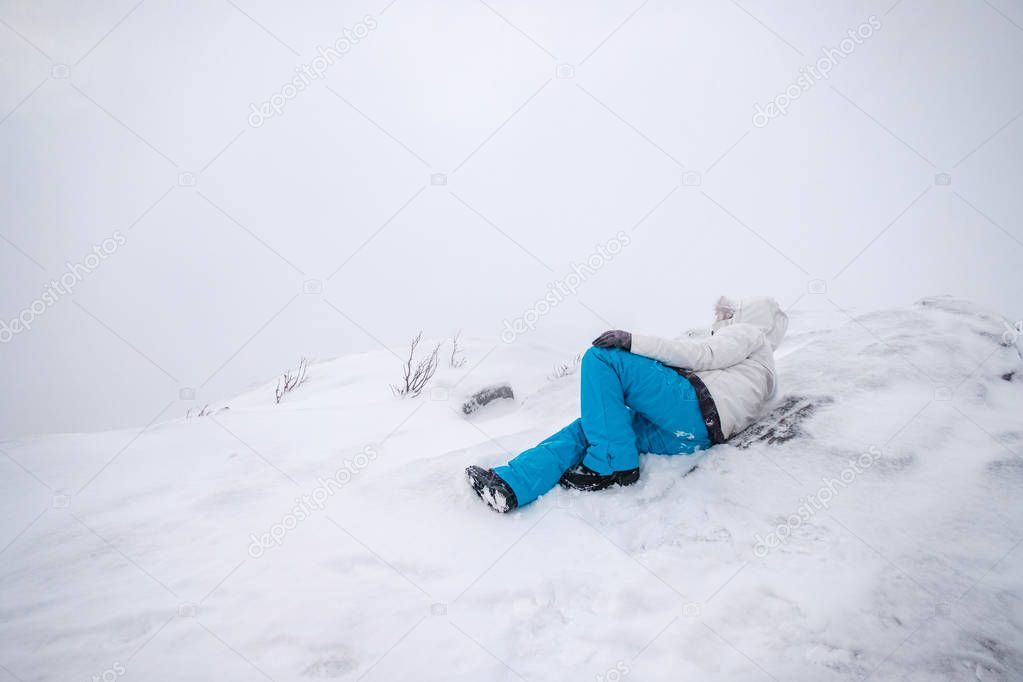 Man mountaineer wearing snow coat with relaxing