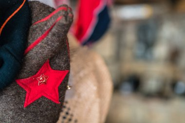 Red star with sickle and hammer attached to the  traditional Balkan folk costume