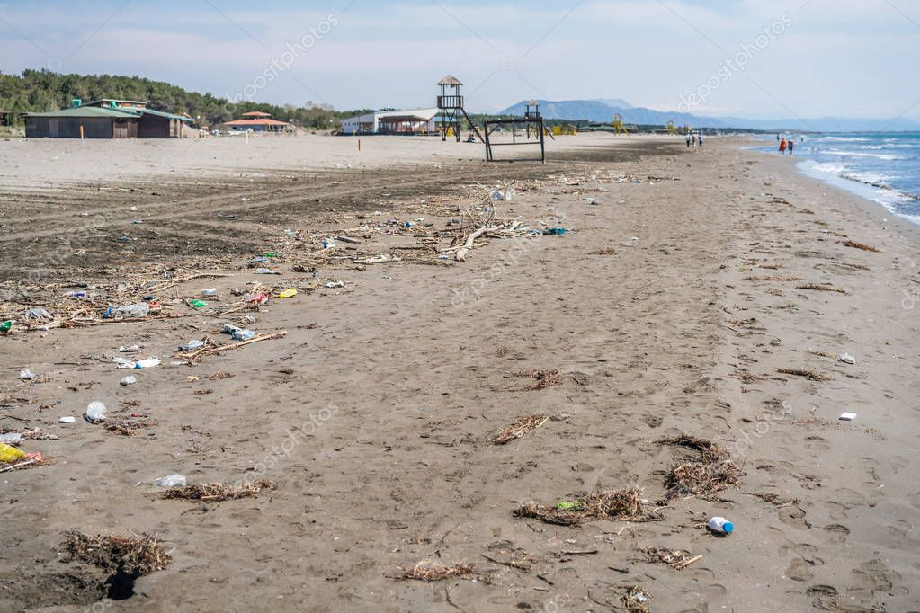 Ulcinj, Montenegro - April 2018 : Large amounts of of the sea washed up rubbish, garbage and plastic bottles on the shore of once beautiful Velika Plaza