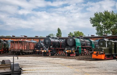 Jaworzyna Slaska, Poland - August 2018 : Old disused retro train locomotives on the side tracks in the depot in the Museum of Industry and Railway in Silesia