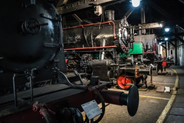 Jaworzyna Slaska, Poland - August 2018 : Old disused retro train locomotives inside the depot hall in the Museum of Industry and Railway in Silesia