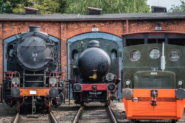 Jaworzyna Slaska, Poland - August 2018 : Old disused retro train locomotives and carriages on the side tracks in the depot in the Museum of Industry and Railway in Silesia