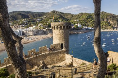 View from the castle to the beach in Tossa de Mar. The walls of the old town, the historic attraction of the Costa Brava. Castle tower by the sea.