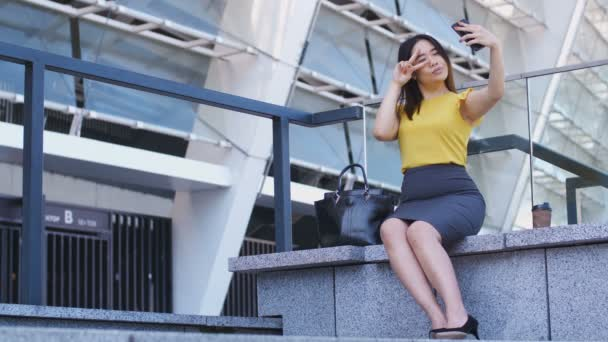 Cute business woman making selfie on smartphone