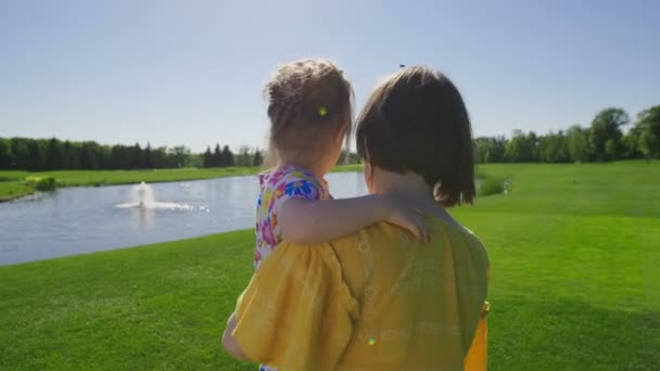 Mom and special need daughter walking on meadow