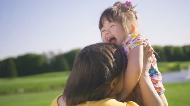Mom and down syndrome daughter enjoying outdoors