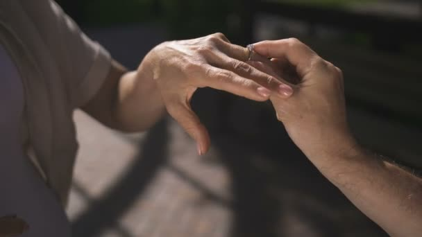 Close-up senior hands while man proposing to woman