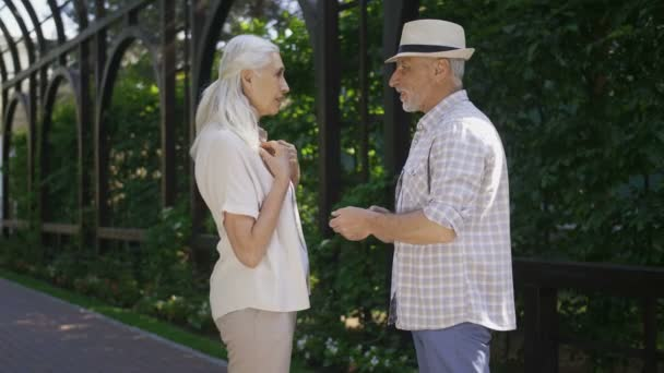 Engaged senior couple looking at camera smiling