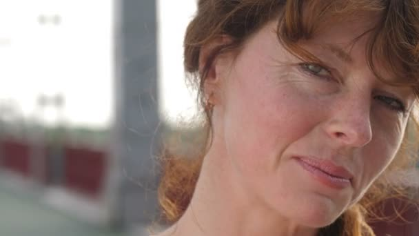 Face of redhead senior woman with freckles smiling