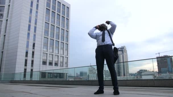 Happy black businessman celebrating promotion