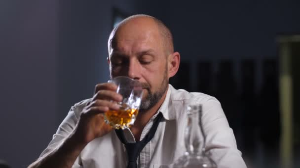 Tired businessman releiving stress with alcohol