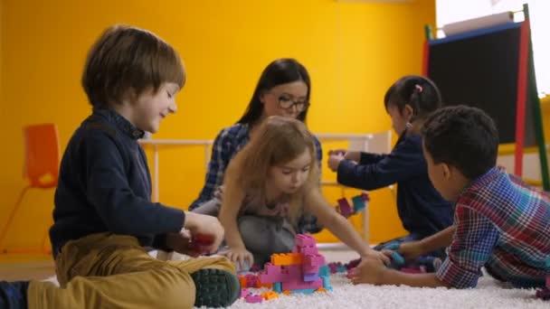 Joyful children enjoying leisure in kindergarten