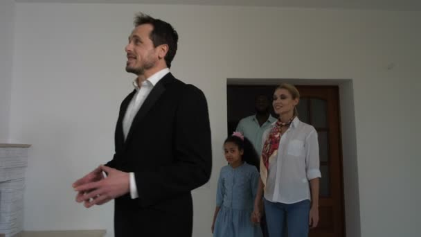 Family looking around house with real estate agent