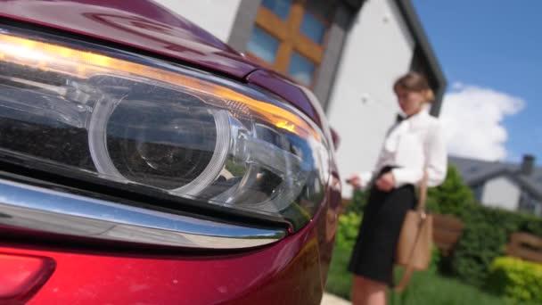 Car headlight flashing while woman unlocking doors