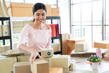 Women are preparing it for shipment to customers in concept of s