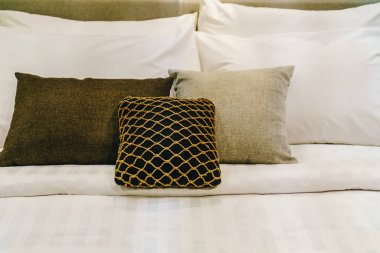 beautiful and comfortable pillow decoration on bed - vintage effect filter