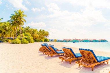 beach chair with tropical Maldives island  beach and sea