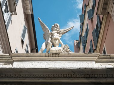 guardian angel over palace in Rome