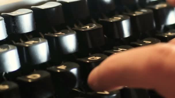 hand writes typewriter, on a typewriter of the eighties in which it was not yet the era of digital