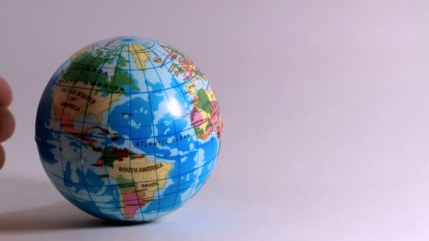 a hand of a man, caresses a globe, ideal footage to explain problems of ecology and bio-ethics