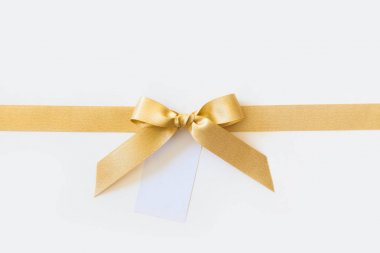 Gold ribbon with a bow as a gift on a white background