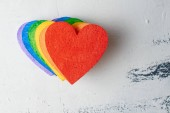 hearts painted in bright rainbow colors on grunge background, LGBT concept