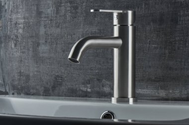Plumbing. The interior of the bathroom. Faucet sink on black and white background.
