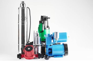 Various pumping equipment for heating and water supply on a white background isolated.