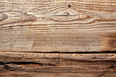 Old wood. Cracked brown background.