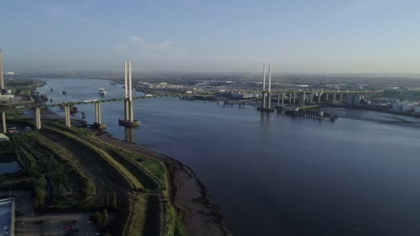 Drone descends slowly with wide view of River Thames and Queen Elizabeth II Bridge.