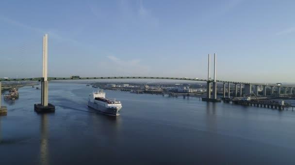 Static aerial clip as  ro-ro cargo ship Adeline passes under Queen Elizabeth II Bridge