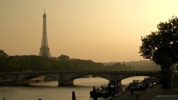 Wide shot of river Seine and Concorde bridge at sunset time in Paris, France. Eiffel Tower in the background