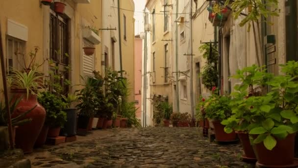 Jib style move up of narrow steep backstreet in Alfama district in Lisbon, Portugal