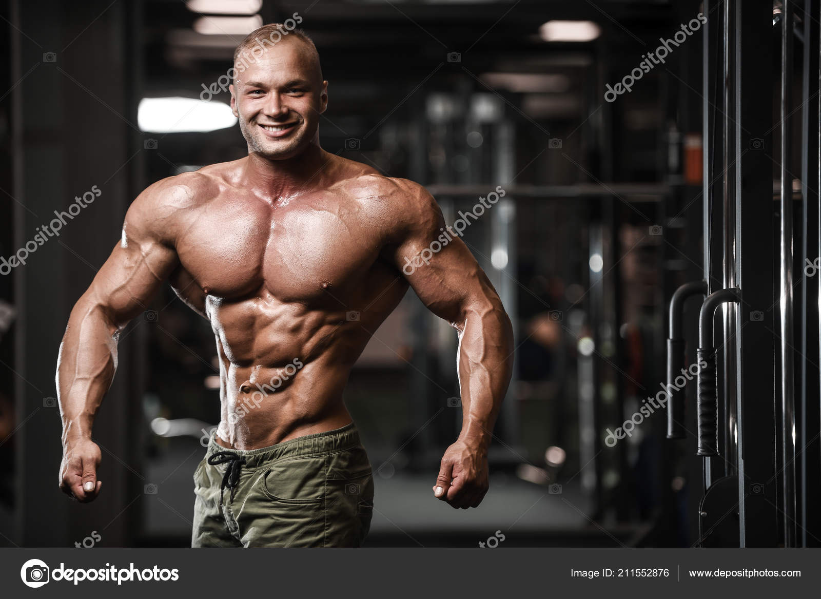 Handsome Strong Bodybuilder Athletic Man Pumping Muscles