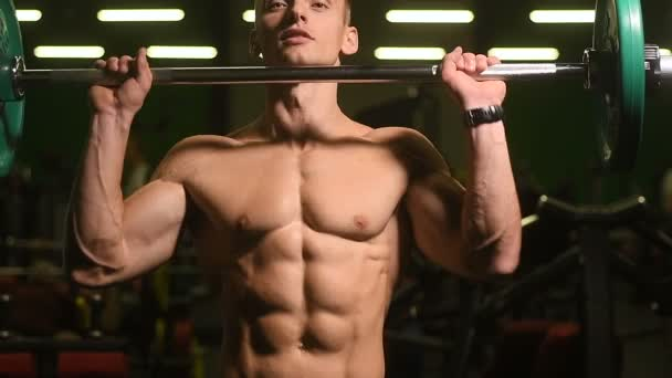 Weightlifting strong athletic men pumping up muscles workout fitness and bodybuilding concept background - muscular bodybuilder fitness men doing barbell military press exercises in gym naked torso