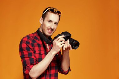 the guy with the camera on a yellow background