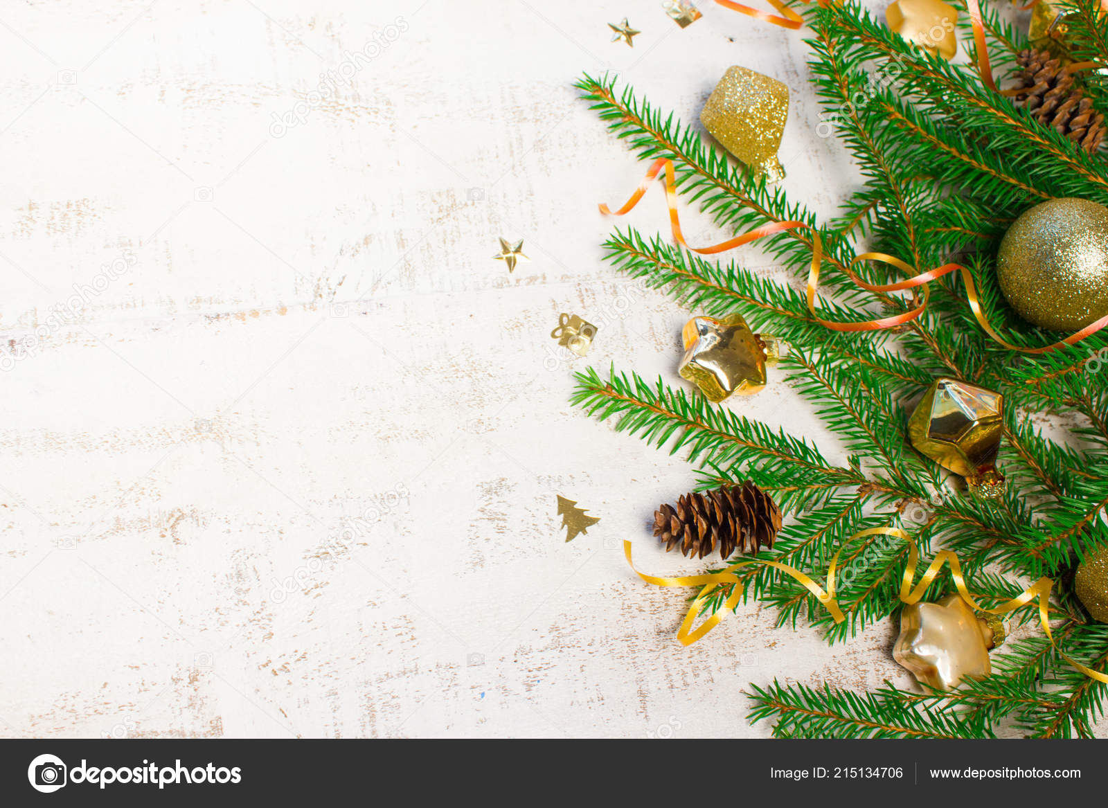 christmas new year background fir tree branches gold glass toys stock photo