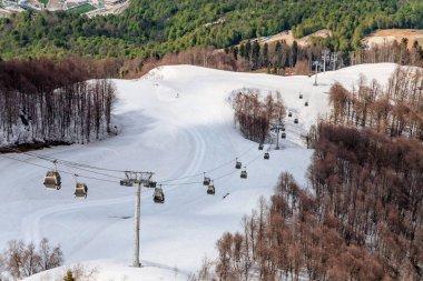Ski lift of Gorky Gorod mountain ski resort at spring. Sochi, Russia. Scenic landscape