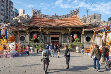 Taipei, Taiwan - March 2019: Long Shan Temple and visitors in Taipei. Long Shan Temple is a Chinese folk religious temple and popular landmark for tourists.