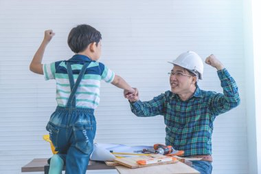 Father and Son fist bump for success concept in construction ind