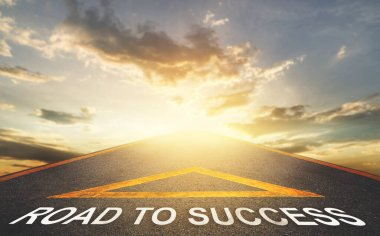 road leading to success with golden sky as a goal for business successs concept.