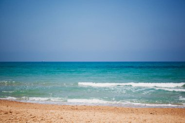 Mediterranean beach with turquoise water in sunny weather