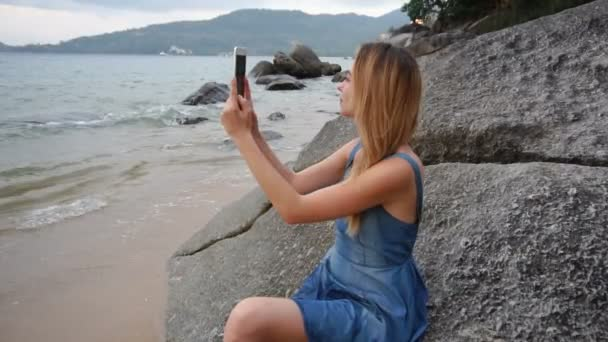 Slow motion traveler girl using tablet shooting video at seaside